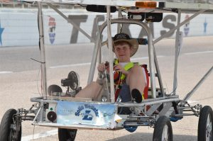 Liberty Christian student takes the solar car for a spin.