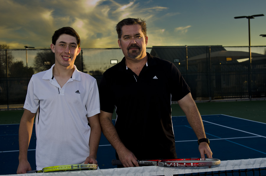Kelly Langdon, the Marcus High School tennis coach, is enjoying working with his son, Sebastian Langdon, a junior on the school's tennis team. (Photo by Bill Castleman)