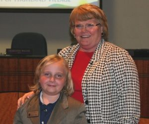 McAuliffe Elementary student Fox Lisby assists Mayor Charlotte Wilcox as Mayor for the Day.
