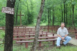 The Rev. Phil Geleske sits in the Little Chapel area within the 70-acre Briarwood Retreat Center off Copper Canyon Road. (Photo by Dawn Cobb)