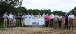 Pictured from left to right: Don Combs, Texas Land Development; Victor Meyers, Victor Meyers Custom Homes; Robert Gravely, Gravely LDS; Gary Kahatschek, Remax Cross Country; Ron Morris, Remax Cross Country; Mario Jaramillo, Jaramco Investments, LLC; Fred Placke, RE/MAX Cross Country; Darrin Peterson, Texas Land Development; Wayne Atkins, Sterling Brook Custom Homes; Michael Leavitt, Highland Village City Manager; Mayor Charlotte Wilcox, City of Highland Village; Taylor Humphrey, Scott Felder Homes; Scott Kriston, Director of Public Works, City of Highland Village; Correen Robinson, Ridinger Associates, Inc.; Brandon McCleskey, Senior Vice-president First State Bank; and Victor Gutierrez de Pineres, Jaramco Investments, LLC.