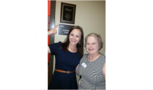 Tiffany Nuche, of Avanti and Mary Kay Walker, president of the Seniors in Motion Auxiliary, stop for a photo outside the new senior center's coffee bar (Photo courtesy of Avanti Senior Living)