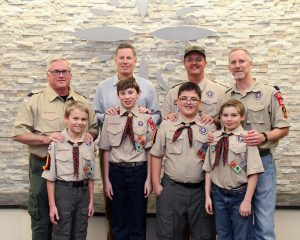 Parker Cone, Donovan Cashen, Christopher Harvey, Paul Rochelle and their fathers pose for a photo during the Cub Scout Pack 1163 of Highland Village Blue & Gold Banquet.