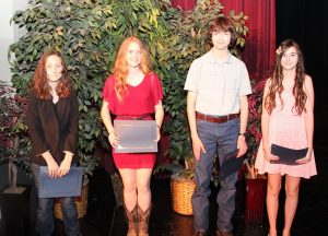 The Jerry Simpson Memorial Short Story Contest winners included (left to right) Grace Teague (honorable mention), Paige Woelke (honorable mention), Samuel Blalock (third place) and Lindsay Tito of Liberty Christian School (second place).