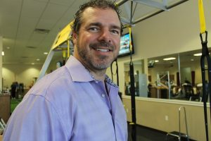 Dan Nevitt, owner of Health in Motion, stands near the TRX resistance training equipment - only one part of the one-stop-shop services his business provides for those seeking a healthier lifestyle.