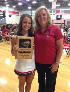 Paulina Bracker and MHS Cheer Coach Nema House.
