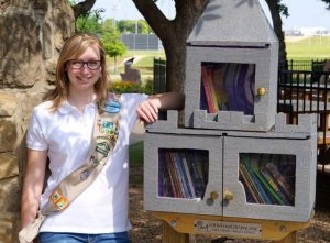 Girl Scout Ambassador Troop 79 and Marcus High School Senior Cassandra Campbell announces the grand opening of the Little Free Library at Kids Kastle, the first of four total mini libraries she will build in Highland Village this summer to earn her Gold Award.