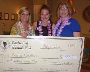 DOWC Community Service Chair, Kathy Shake (left) presenting the Scholarship award to Kayla Blackmon, with her mother Monica Blackmon, at the club's last general meeting in May.