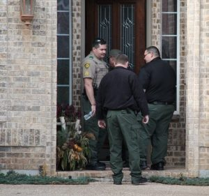 Denton County Sheriff's Office deputies execute a search warrant on Terrace Drive early Tuesday.