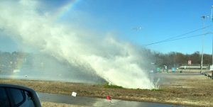 A resident snaps a photo of the water main break off Morriss Road at Garden Road.