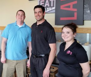 Pizza Hut Area Coach Josh Stidham, General Manager D. Wesley Marshall and Assistant Manager Candace Ledford at the new Pizza Hut restaurant in Lantana.