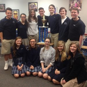 Liberty Christian Advanced Theatre students in Encore pose with their first place trophy.