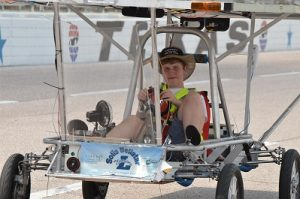 Liberty Christian senior Neiman Walker takes a spin in the solar car at the 2014 Solar Car Challenge at Texas Motor Speedway.