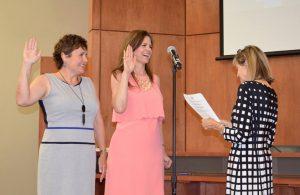 Kronda Thimesch (left) and Trisha Sheffield take oaths.