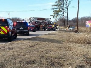 Flower Mound police and firefighters work to treat driver who flipped his car off FM 2499. (Photo by Steve Southwell)